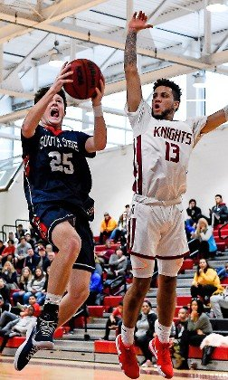 South Side's Eamon McGowan, left, who scored 15 points, drove past Glen Cove's Jared Jackson during last Saturday's 54-45 Cyclones' victory.