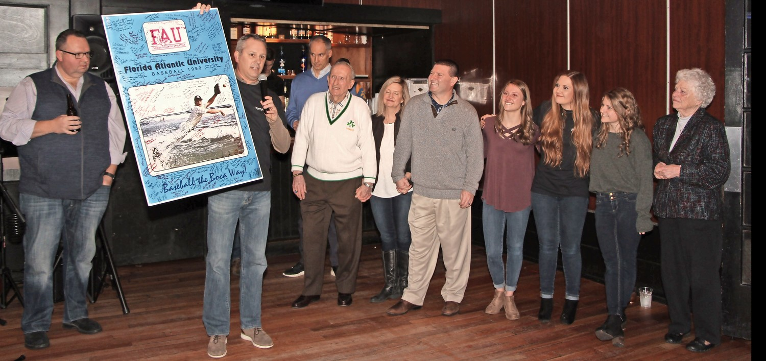 Sean O'Brien, center, was joined by family and friends while his good friend Brian Baker spoke to the crowd who attended the event at Kasey's.