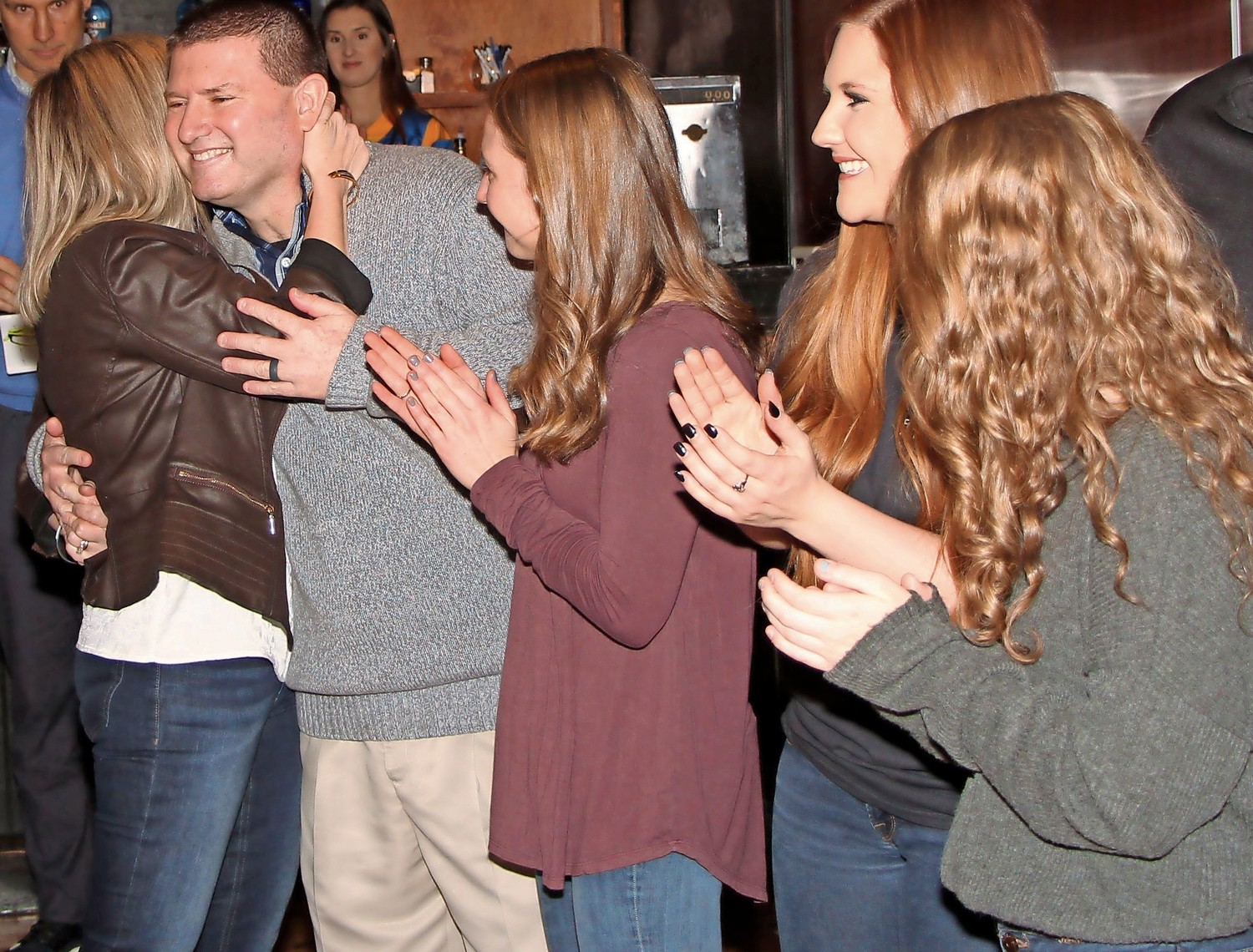 Heather O'Brien embraced her husband Sean. They were joined by their daughters Kailyn, 21, Meghan, 20, and Holly, 18.