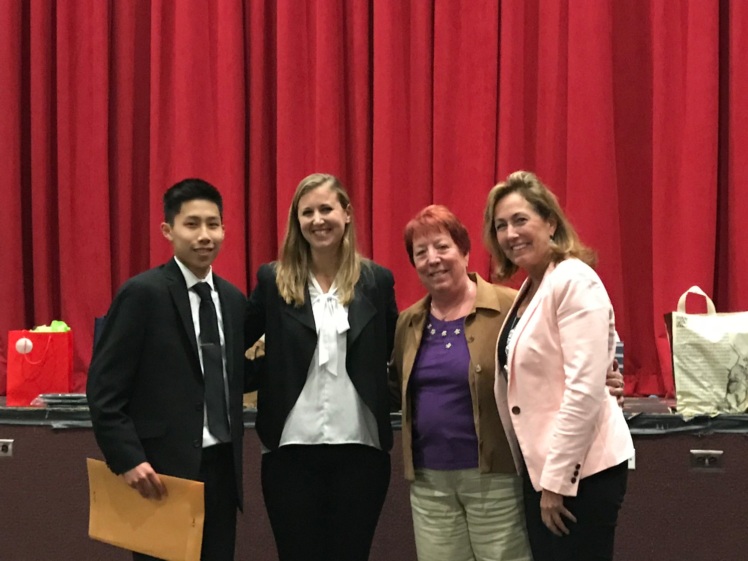 South Side High School student Joseph McNair, left, was granted the Ken Pribil Jr. Foundation's 13th annual scholarship by Ken's sister, Jacqueline Morreale, to his left, Kathleen La Vache, Ken's aunt, and Lorette Pribil, Ken's mother.