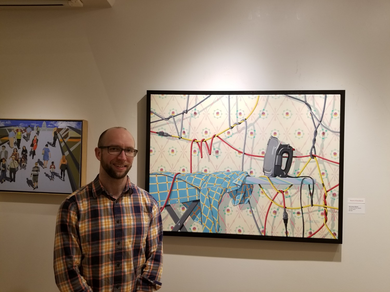 "Wantagh native Nicholas Alberti's painting, ""Ironing Out the Details,"" won an award earlier this month in the Art League of Long Island's 59th Long Island Artists Exhibition."