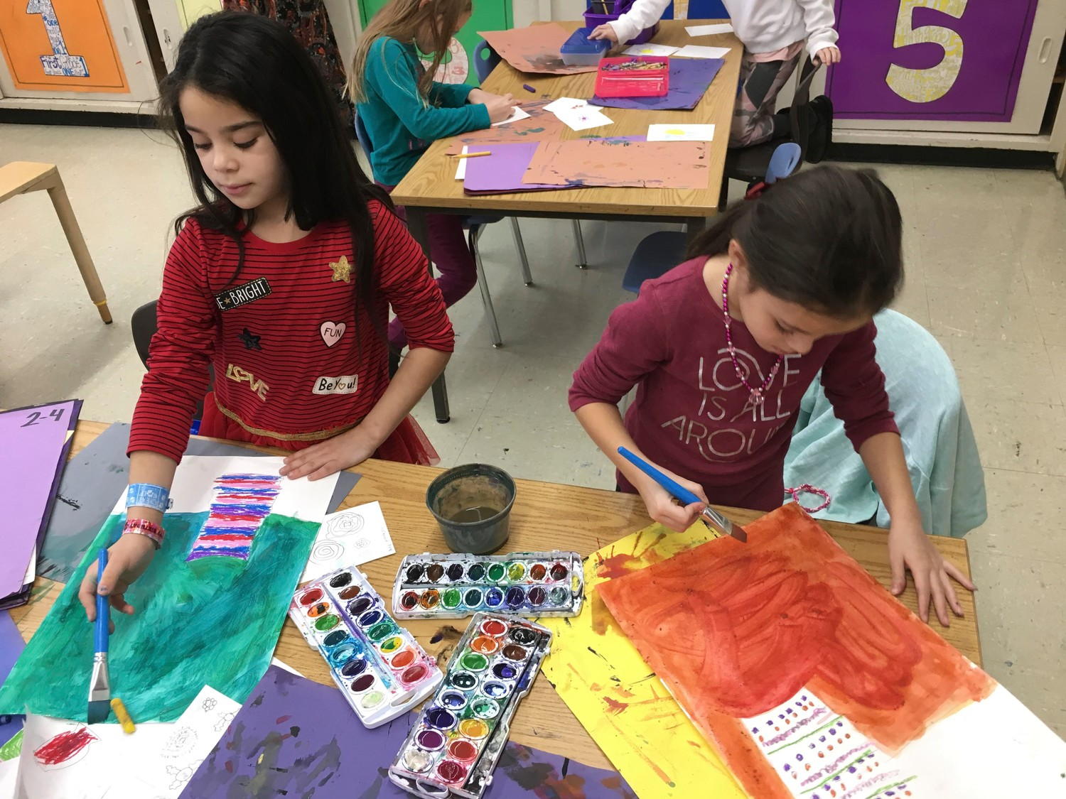 Second-graders Anny Hernandez, left, and Layla Raposo painted Van Gogh-style artwork in teacher Jamie LaSota's class during Seaford Manor Elementary School's International Week.