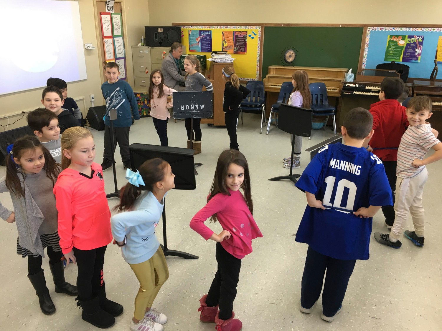 Teacher Jean Marie Aplustille's second-grade class participated in the traditional French dance Los Tachos during a music lesson taught by Rich Adams.