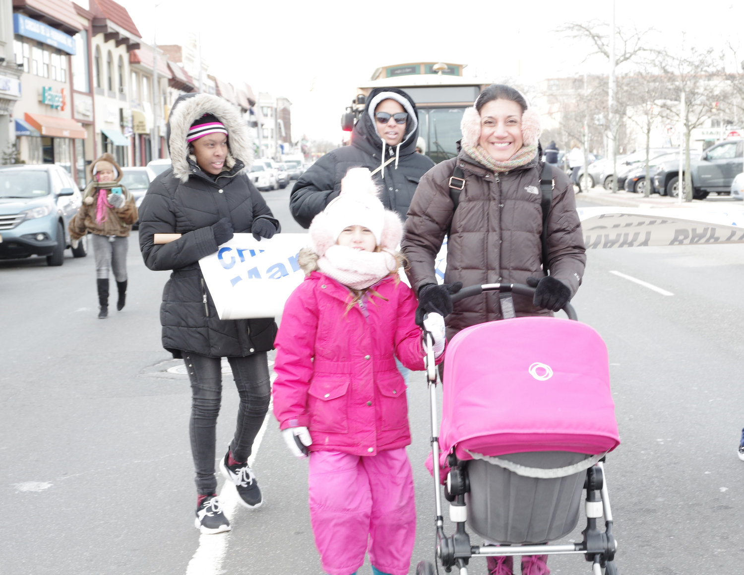Julia Lopez and her daughter, Dylan, 7, were among those who braved the sub-zero wind chill to march in King's memory.