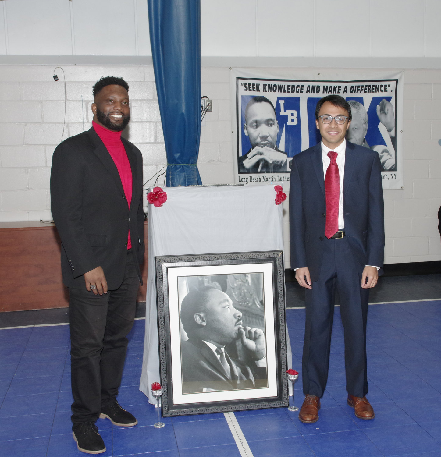 MLK Center Board Chairman James Hodge, left, and the event's keynote speaker Nikhil Goyal.