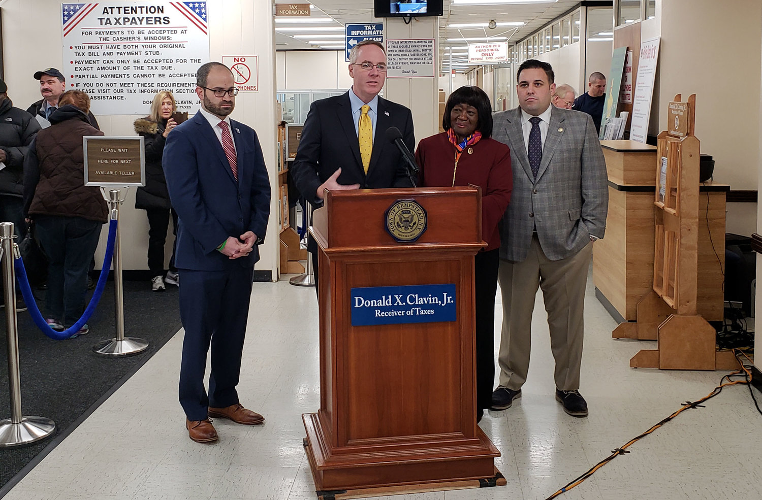 At a news conference on Jan. 17, Town Receiver of Taxes Donald X. Clavin, at lectern, along with State Assemblyman Ed Ra, left, Town Councilwoman Dorothy Goosby and Town Councilman Anthony D'Esposito, called for a 90-day extension of the property tax payment deadline in order to provide relief to federal workers.