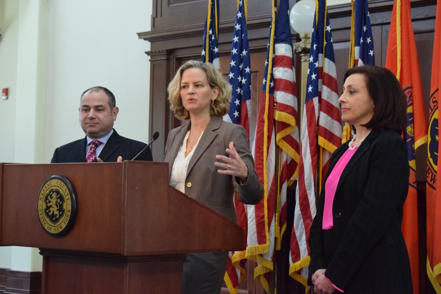 Nassau County Executive Laura Curran announced that Ana Sousa, right, the director of audits and grants in the Office of Management and Budget, will lead a watchdog agency to oversee the county's assessment departments with Ray Orlando, the deputy executive for finance.
