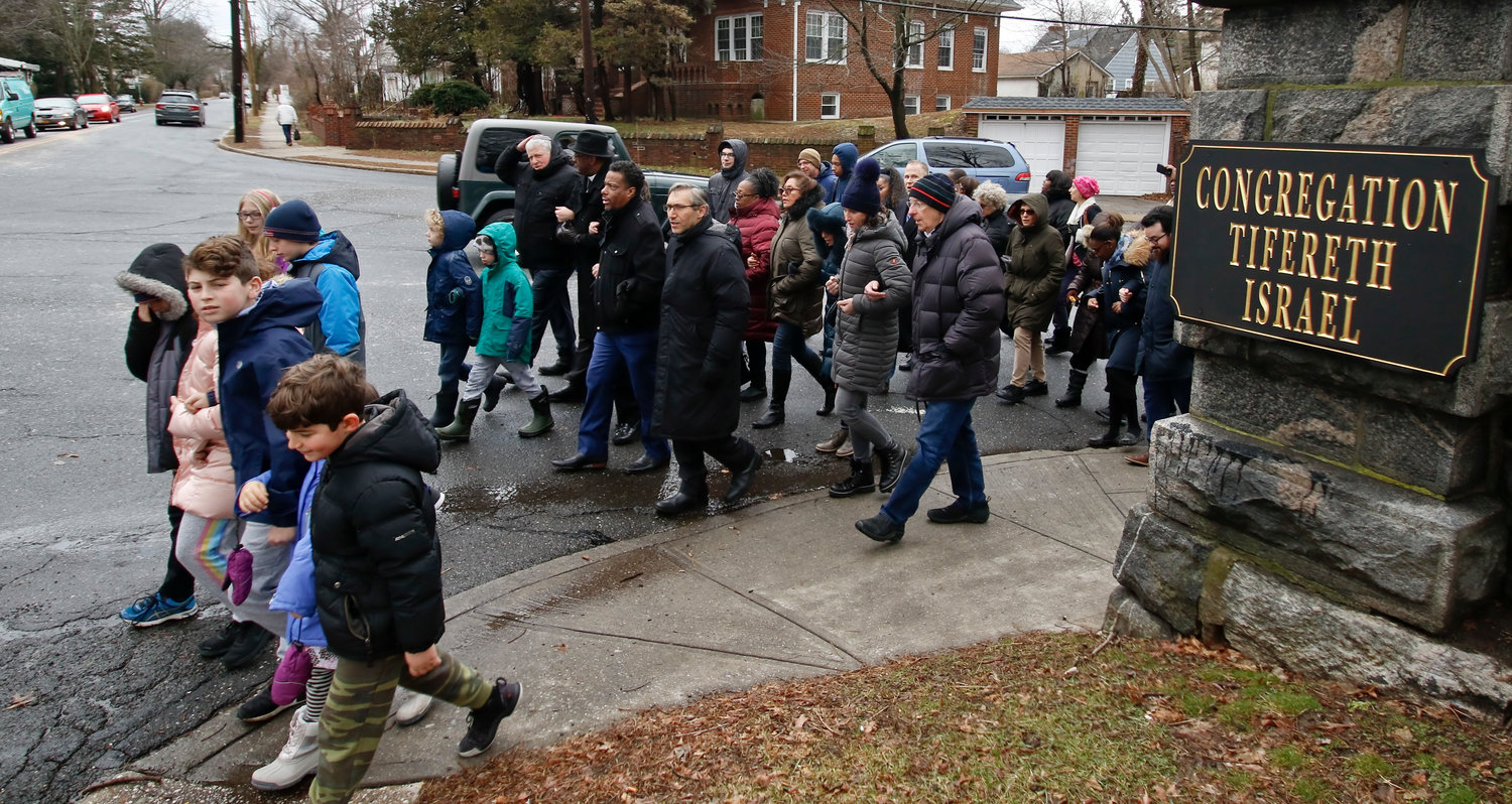 Congregants from Tifereth Israel, First Baptist Church and Calvary AME Church braved the frigid temperatures, singing, arm in arm to honor the legacies of Martin Luther King Jr. and Anne Frank who would have turned 90 this year.
