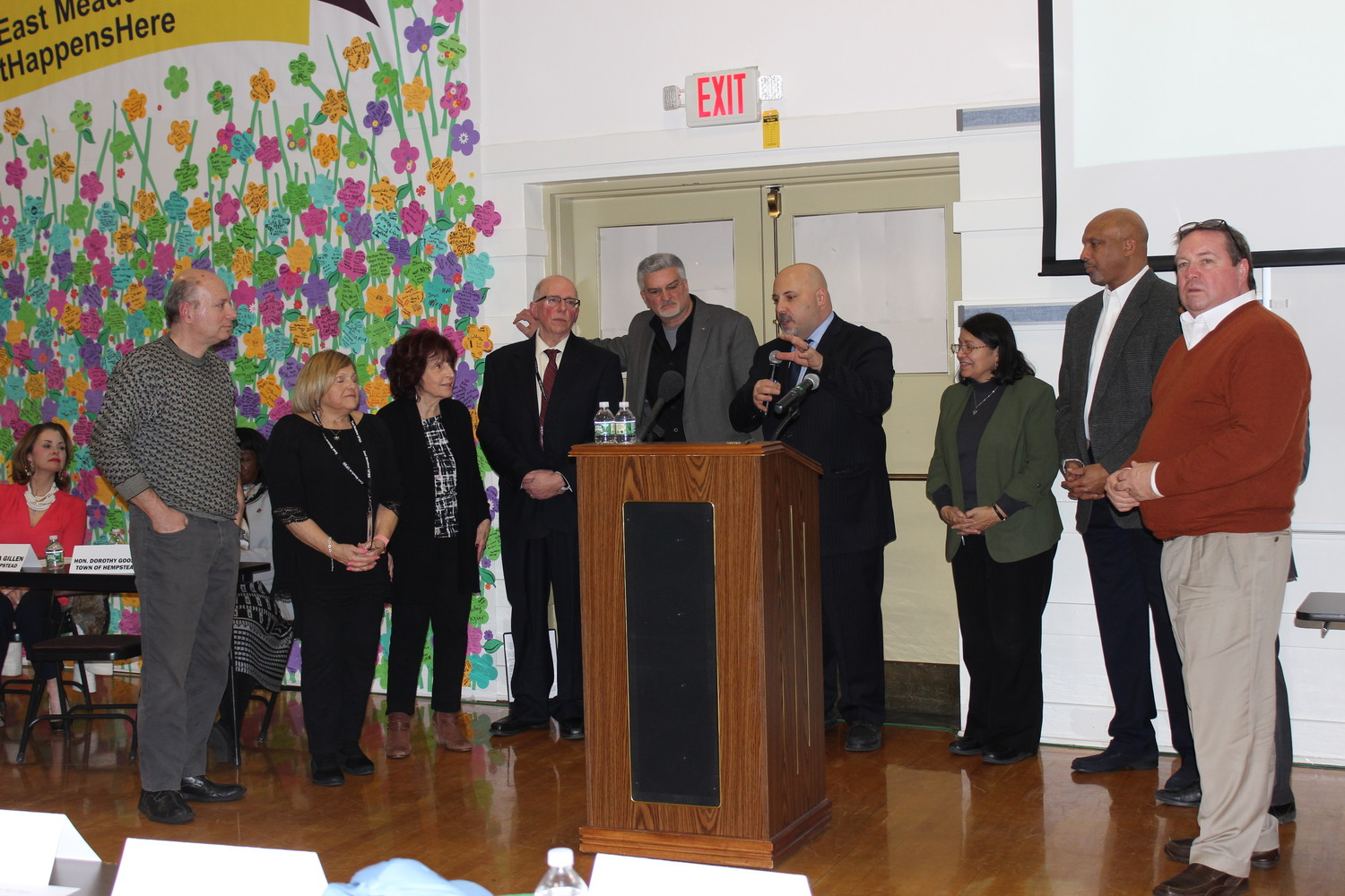 Eric Alexander, the director of Vision Long Island, fourth-from-right, with the East Meadow Chamber of Commerce hosted a meeting for leaders from the communities surrounding Nassau Coliseum to learn more about the proposed $1.5 billion plan to develop the 72 acres surrounding it. From East Meadow were Mike Panagatos, left, Helen Meittinis, Norma Gonsalves, Joe Parisi and Chamber President Frank Camarano.