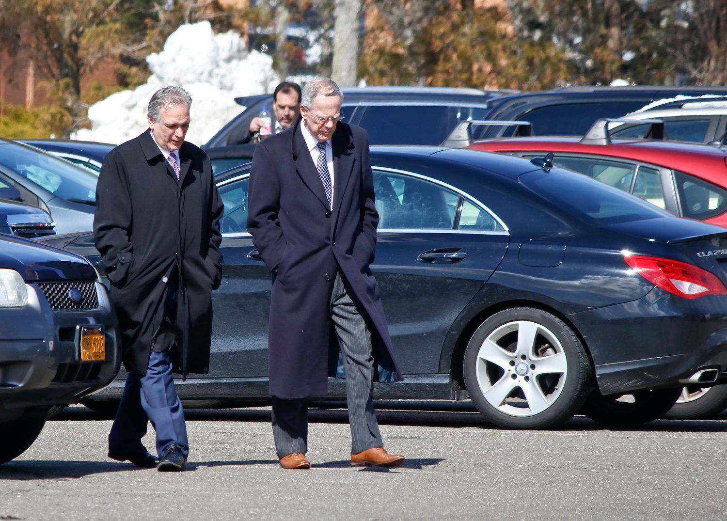 Former Nassau County Executive Ed Mangano, left, is being retried on charges that he accepted bribes from restaurateur Harendra Singh for political favors.