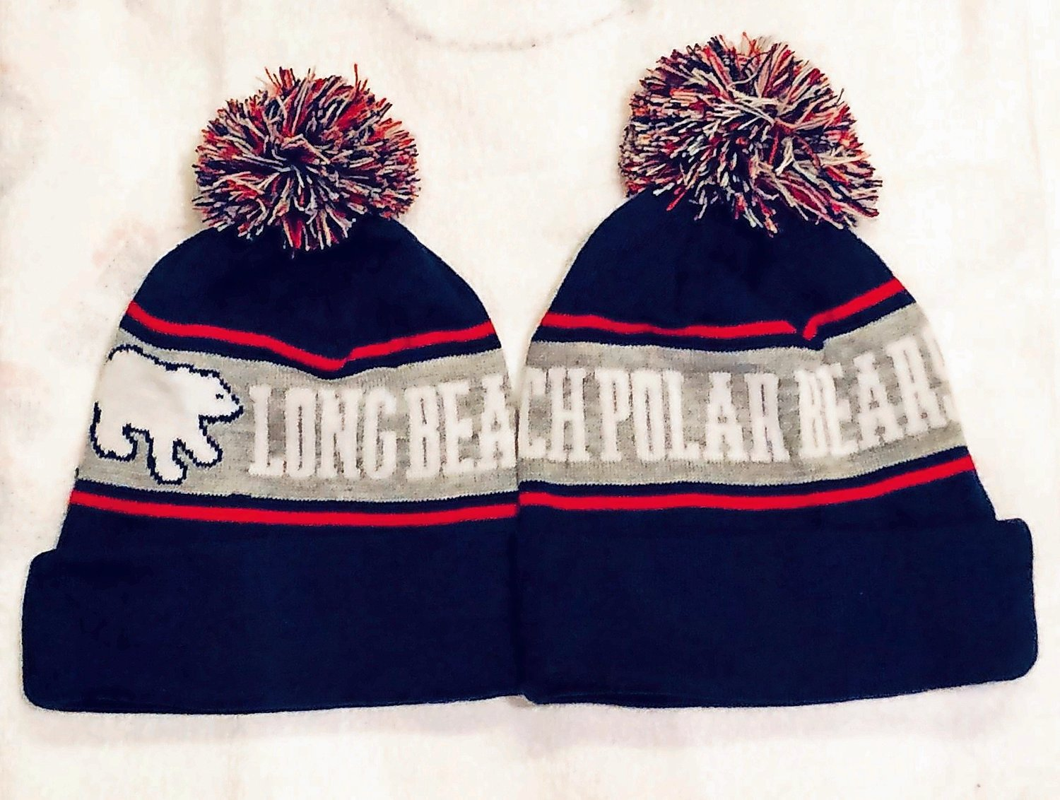 Stay warm in these Polar Bear knit hats.