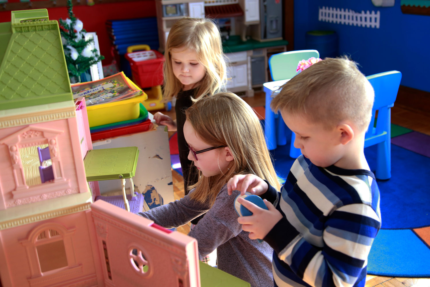 Catherine Campbell, 8, left, with her siblings Emma and Daniel, both 5, played in the pre-kindergarten classroom.