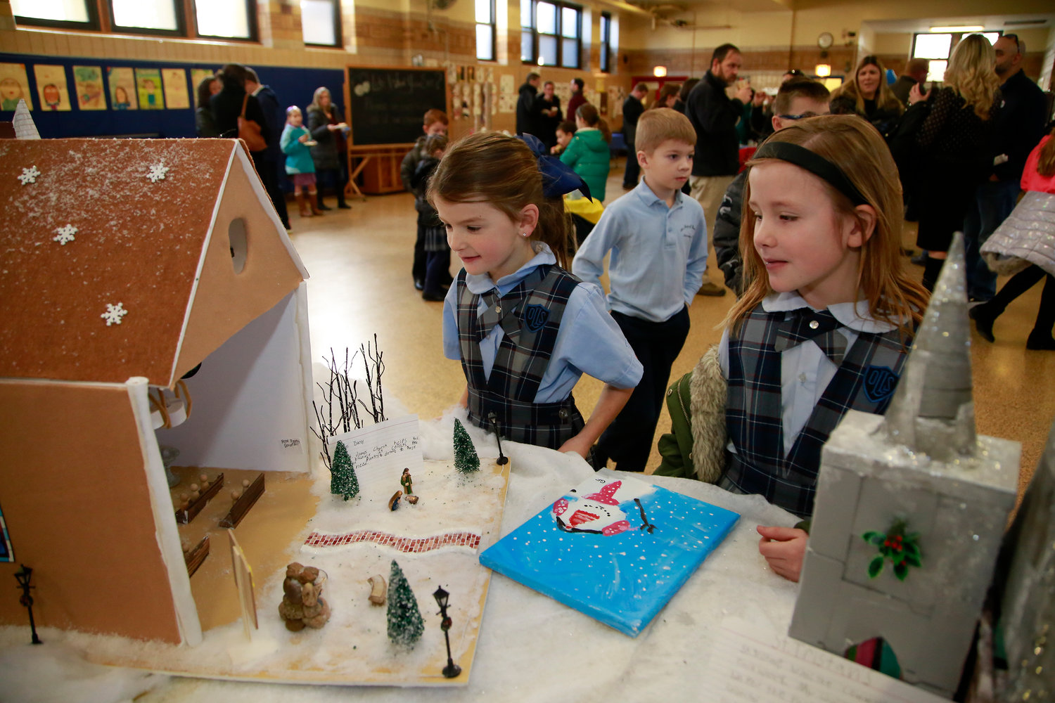 First-graders Cate Darcy, left, and Mae Lawler saw miniature churches.
