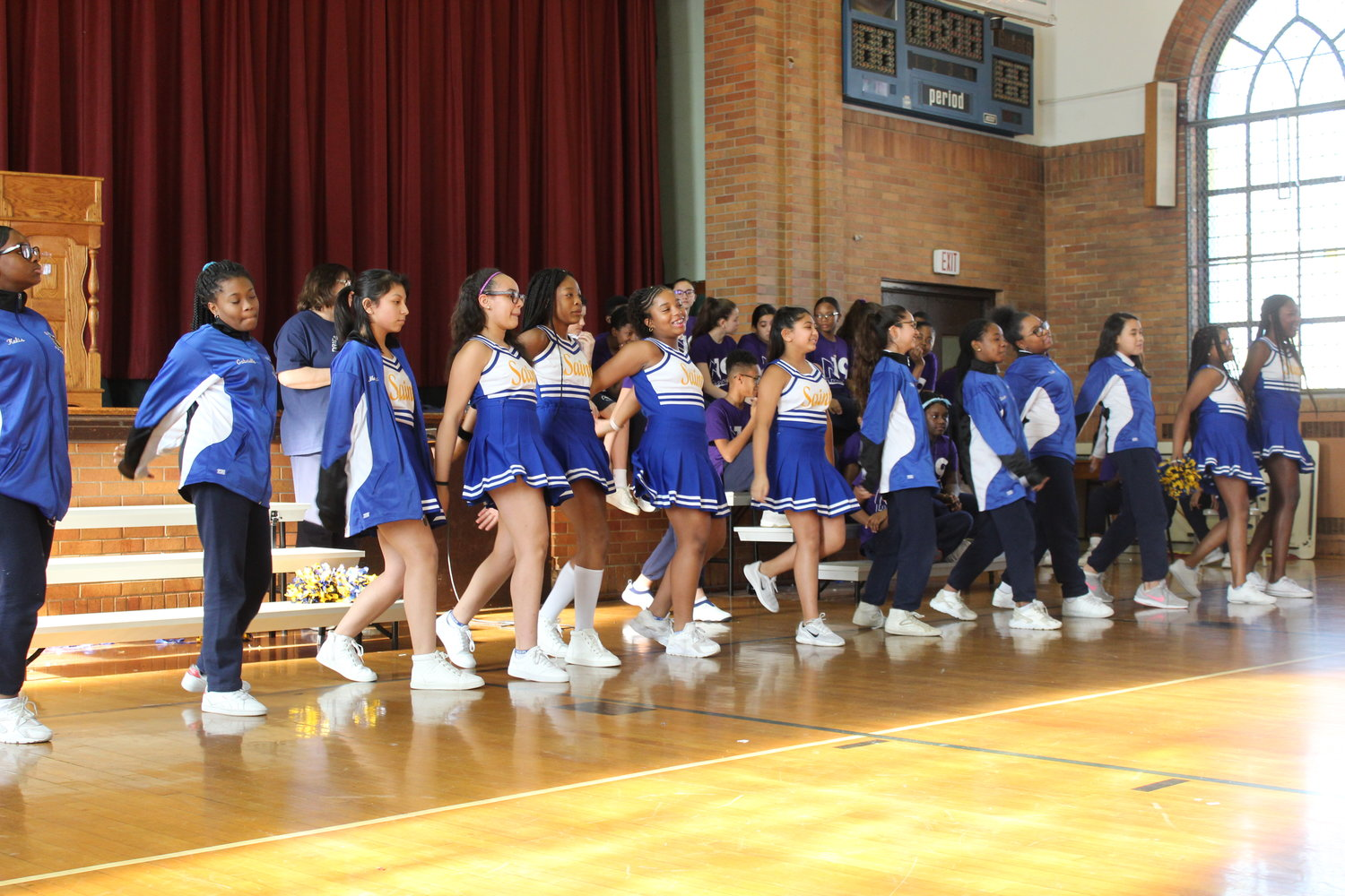 The Holy Name of Mary cheerleaders cheered on the faculty in their annual match against the school's eighth-graders.