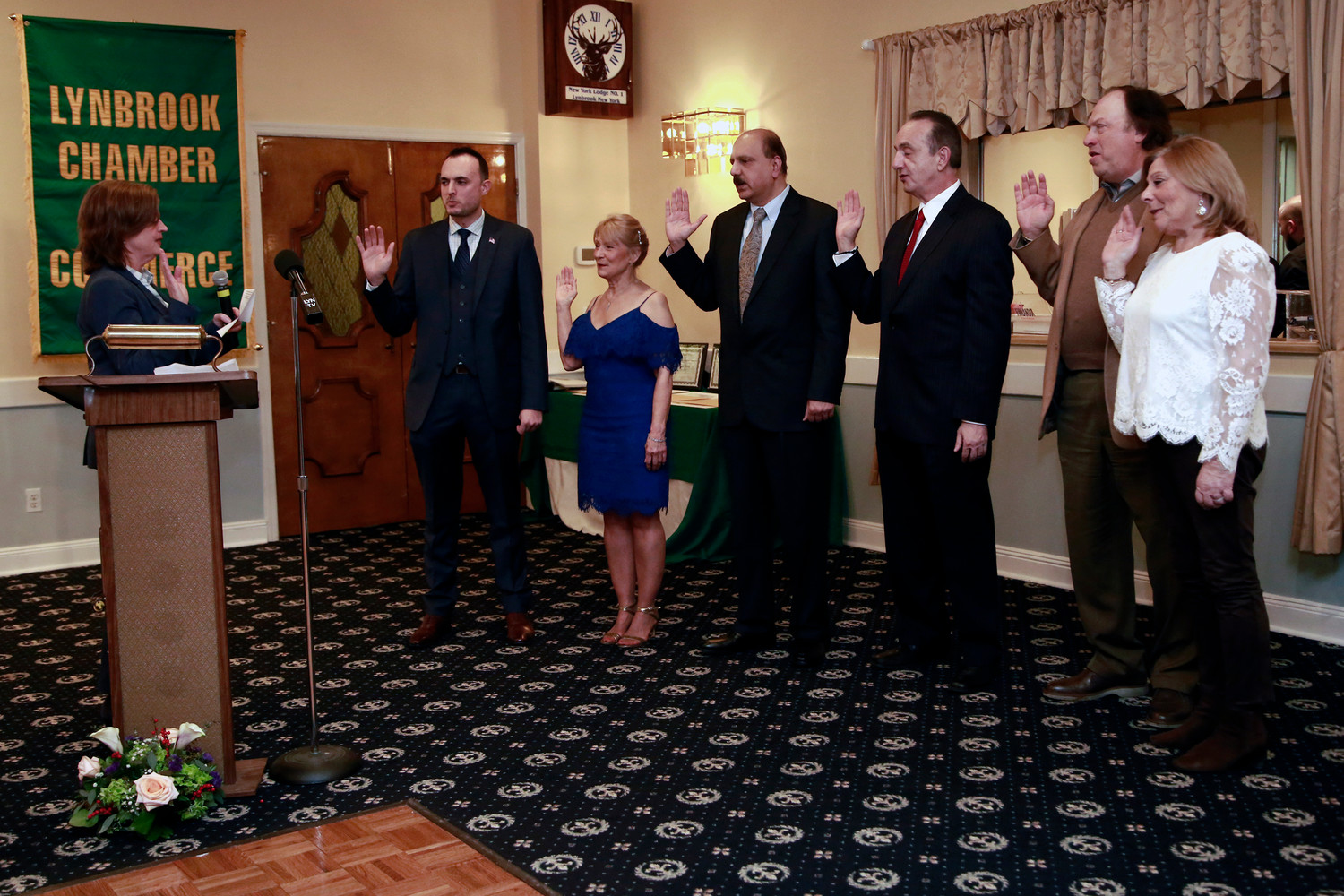 At the Lynbrook Chamber of Commerce's annual installation dinner, Assemblywoman Judy Griffin, far left, swore in, from left, Vice Presidents Michael Davies, Polly Talbott, John Hajisava, Brude Hafner, Jeffrey Greenfield and Rhonda Glickman.