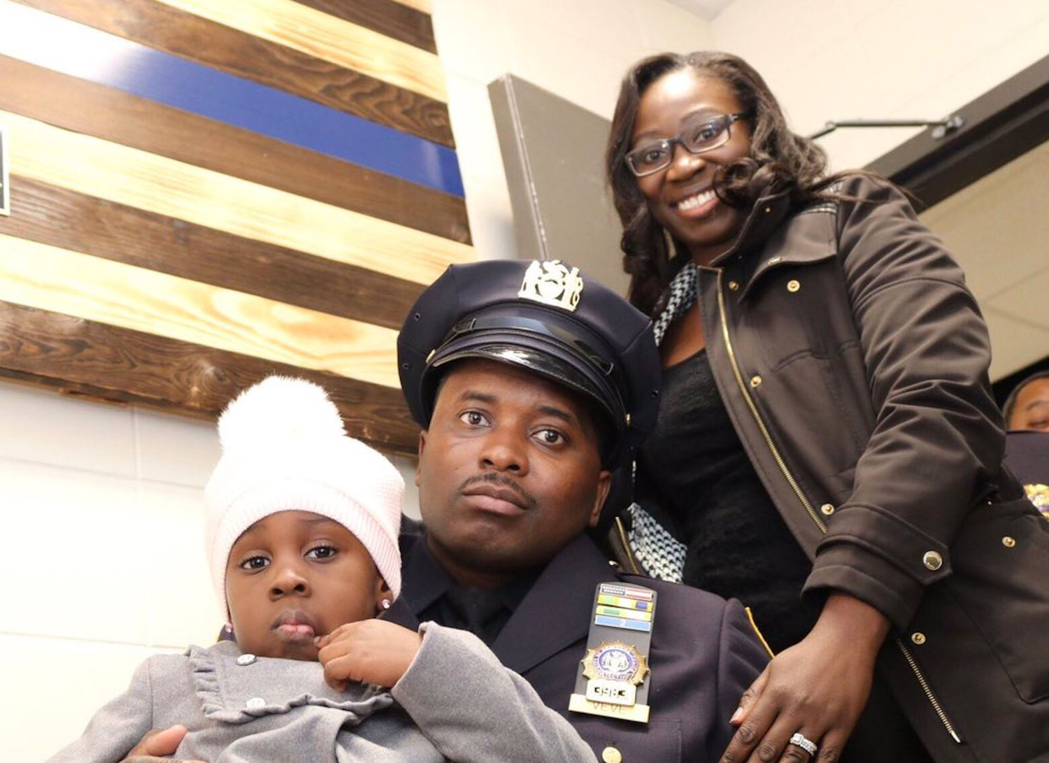NYPD Detective Dalsh Veve with his wife, Esther, and their daughter.