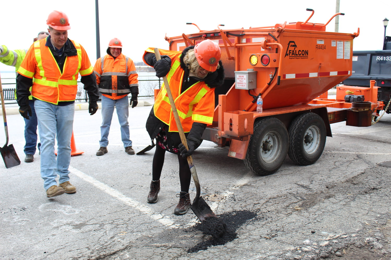 Nassau County Executive Laura Curran helped memberrs of the public works staff fill potholes in a parking lot on The Boulevard in Sea Cliff on Jan. 23.