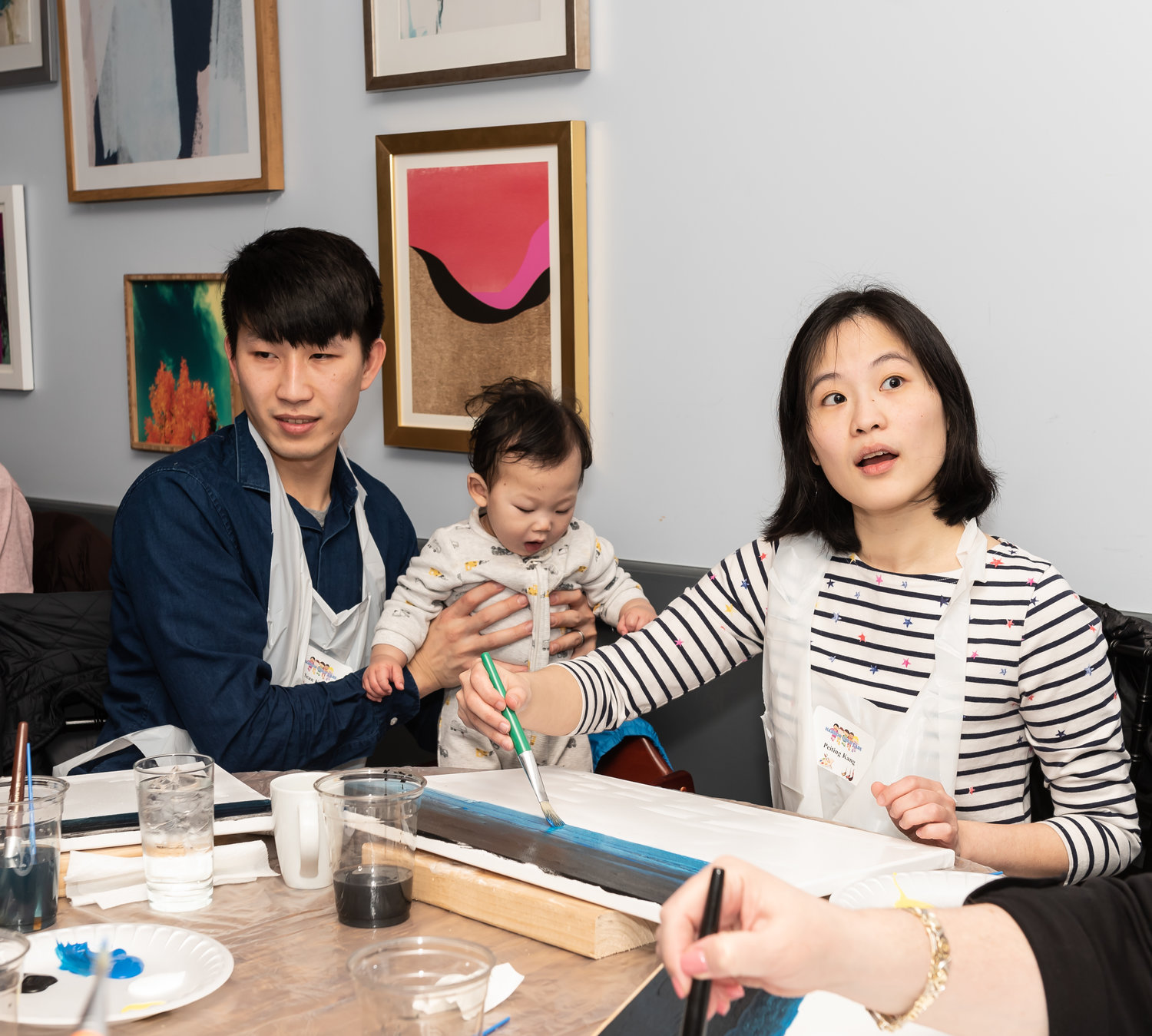 Sean and Peiting Kang brought their 10-month-old, Ryan, to the paint night to give him an early lesson in the arts.