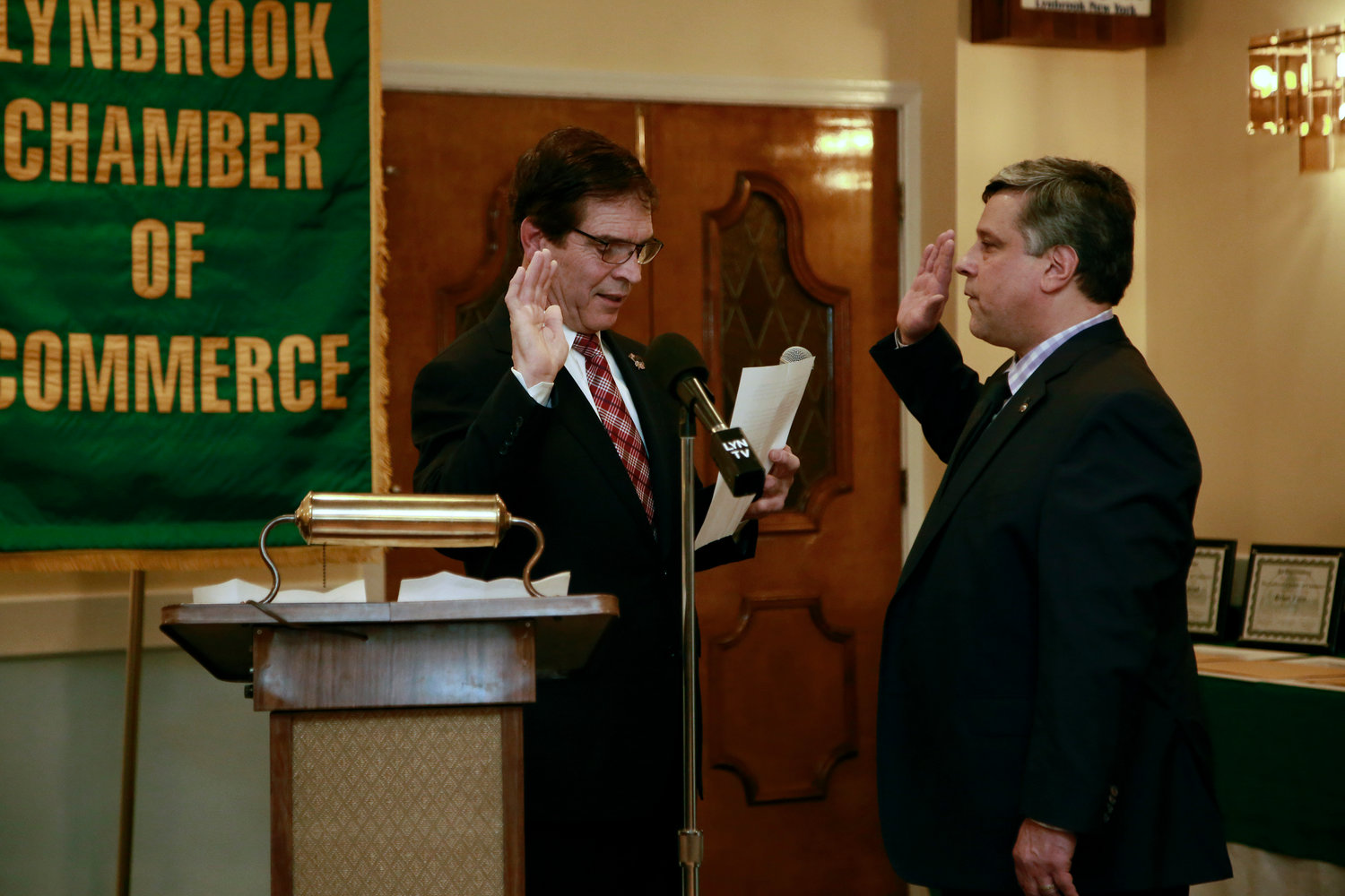 Stephen Wangel, right, was sworn in as president by Lynbrook Mayor Alan Beach.