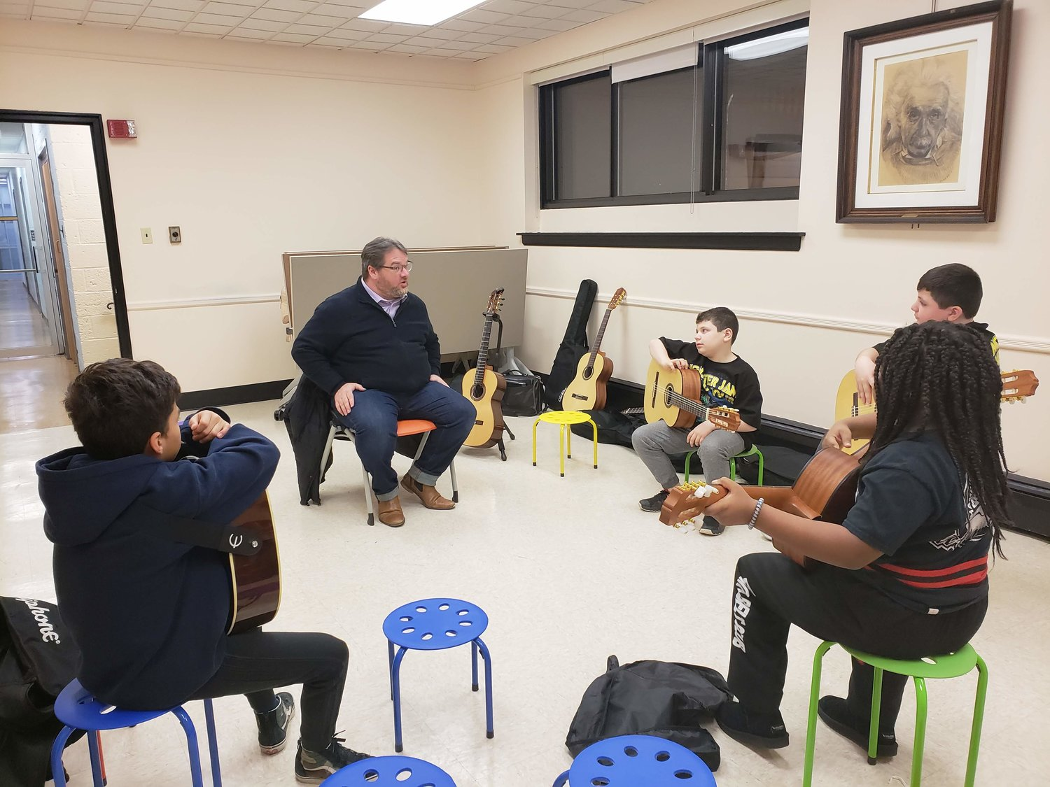 Guitar instructor Chris Gotzen-Berg, of the Legato Foundation, reviewed the goals for the eight-week-long class with students on the first night of lessons at the Freeport Memorial Library on Jan. 28.