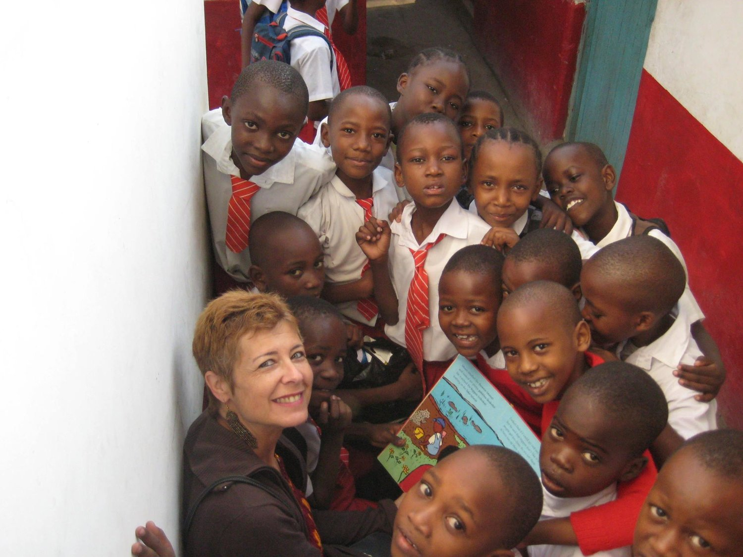 Reason 2 Smile Executive Director Donna Rosenblum travels to Jambo Jipya twice a year to oversee capital project and to deliver donations like those from Seaford Manor Elementary.
