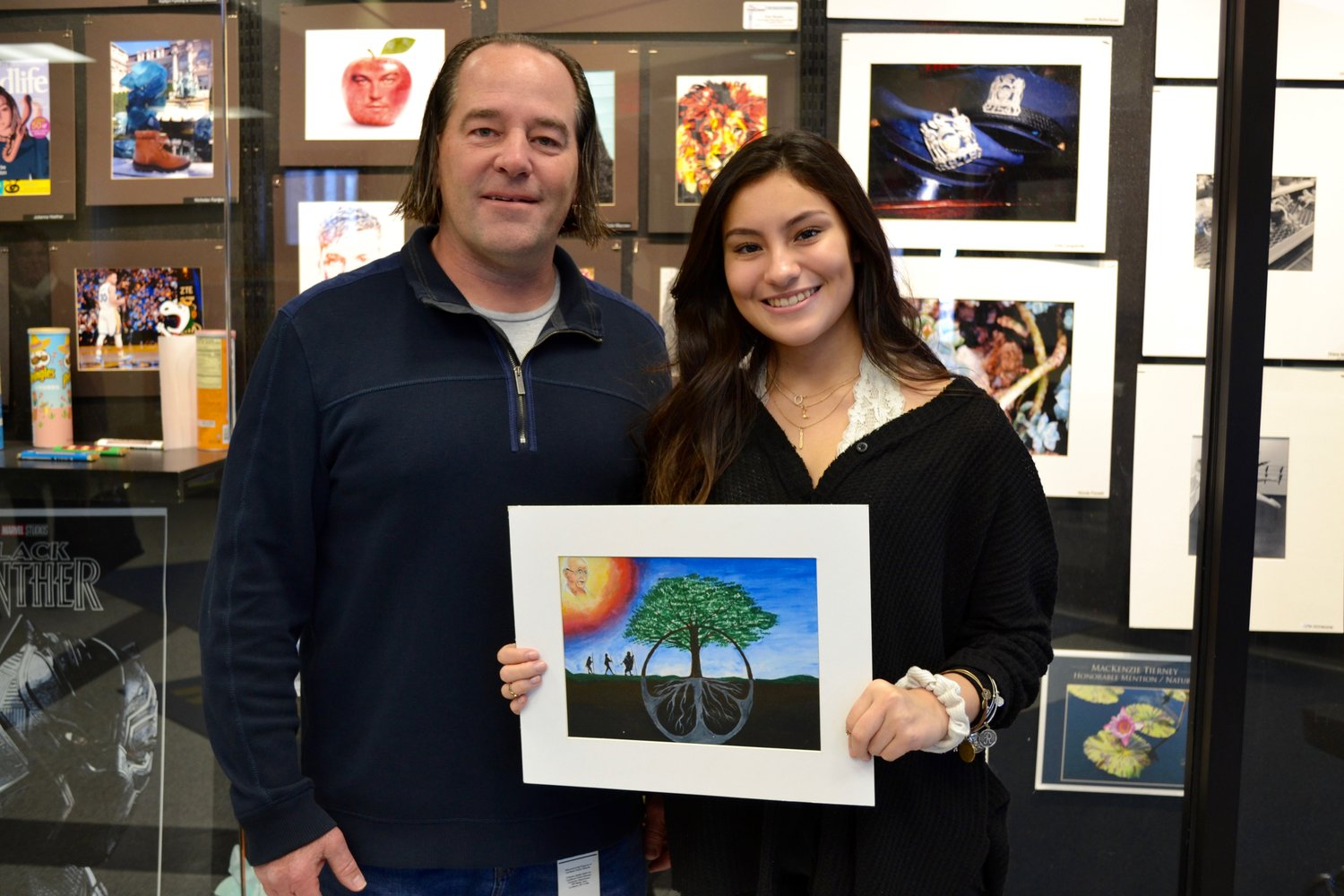 Rosita Bohorquez, right, a Levittown junior, with art teacher Tom Bobal. Bohorquez's paintig  was selected to be included in the Shanti Fund's 13th Anniversary 2019 Peace Art Calendar.