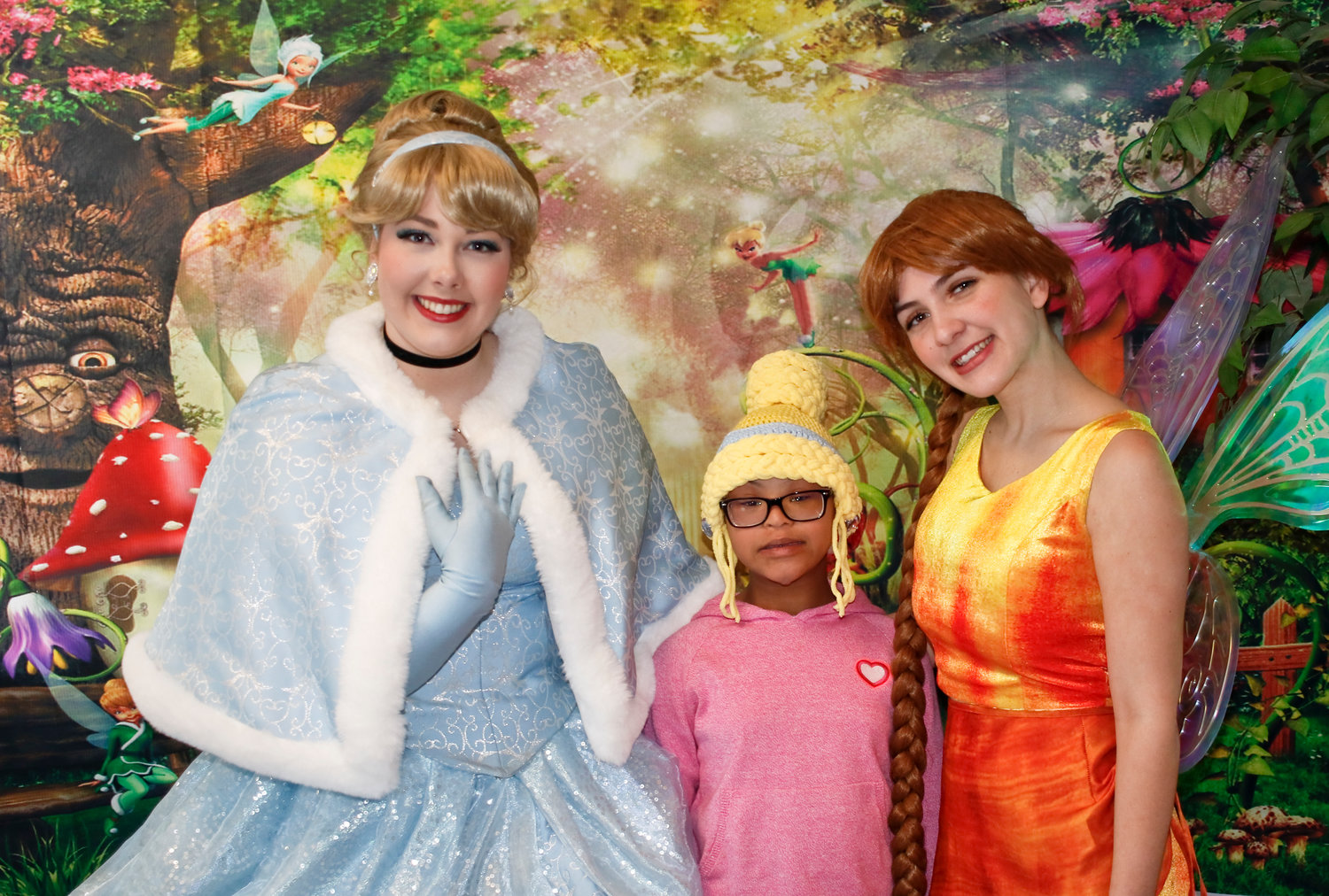 Members of the Magic Yarn Project, who were dressed as Disney characters, surprised Sydney Clarke, a fourth-grader at Davison Avenue Intermediate School in Malverne, with gifts and two Disney-inspired wigs on Jan. 31.