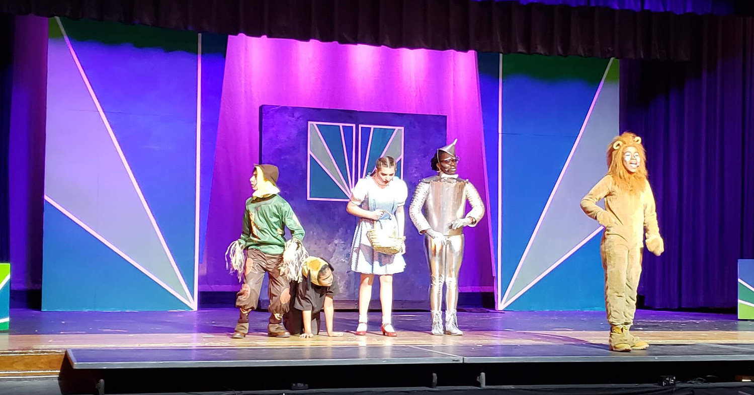 "Kaiden Ulysse, who played the Cowardly Lion, sang, ""If I Were King of the Forest,"" at Howard T. Herber Middle School's musical last month. He was joined by the Scarecrow, Aidan Adycki; Dorothy, Kaylee Palmer; and the Tin Man, Seyi Adeniyi."