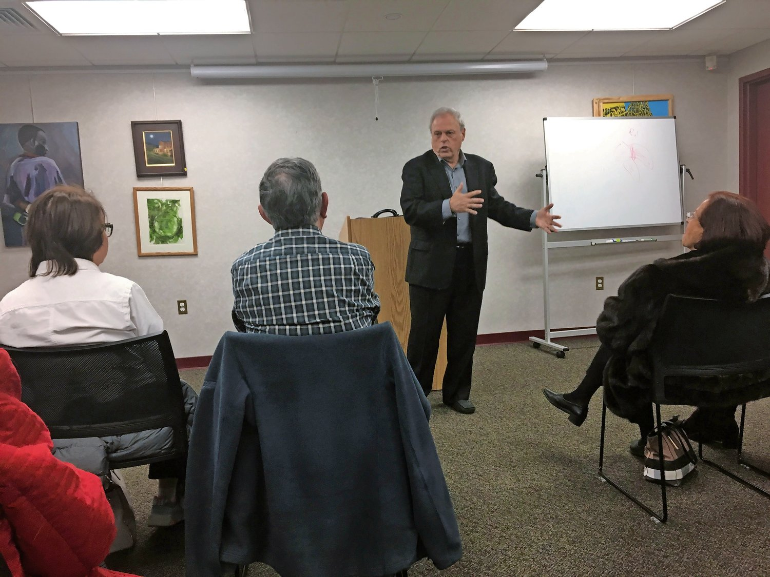 Dr. William Reszelbach, whose mother and father survived the Holocaust, spoke at the Rockville Centre Public Library on Jan. 29.