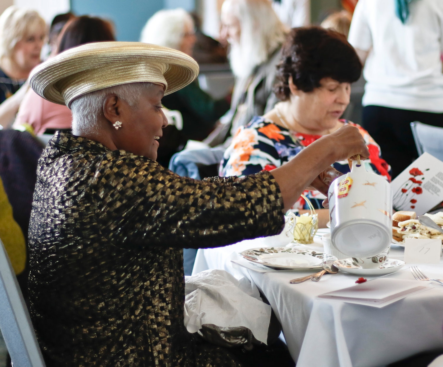 Mildred Bishop refilled her teacup at the 15th annual Historical Society of  East Rockaway and Lynbrook Winter Tea fundraiser on Jan. 27.