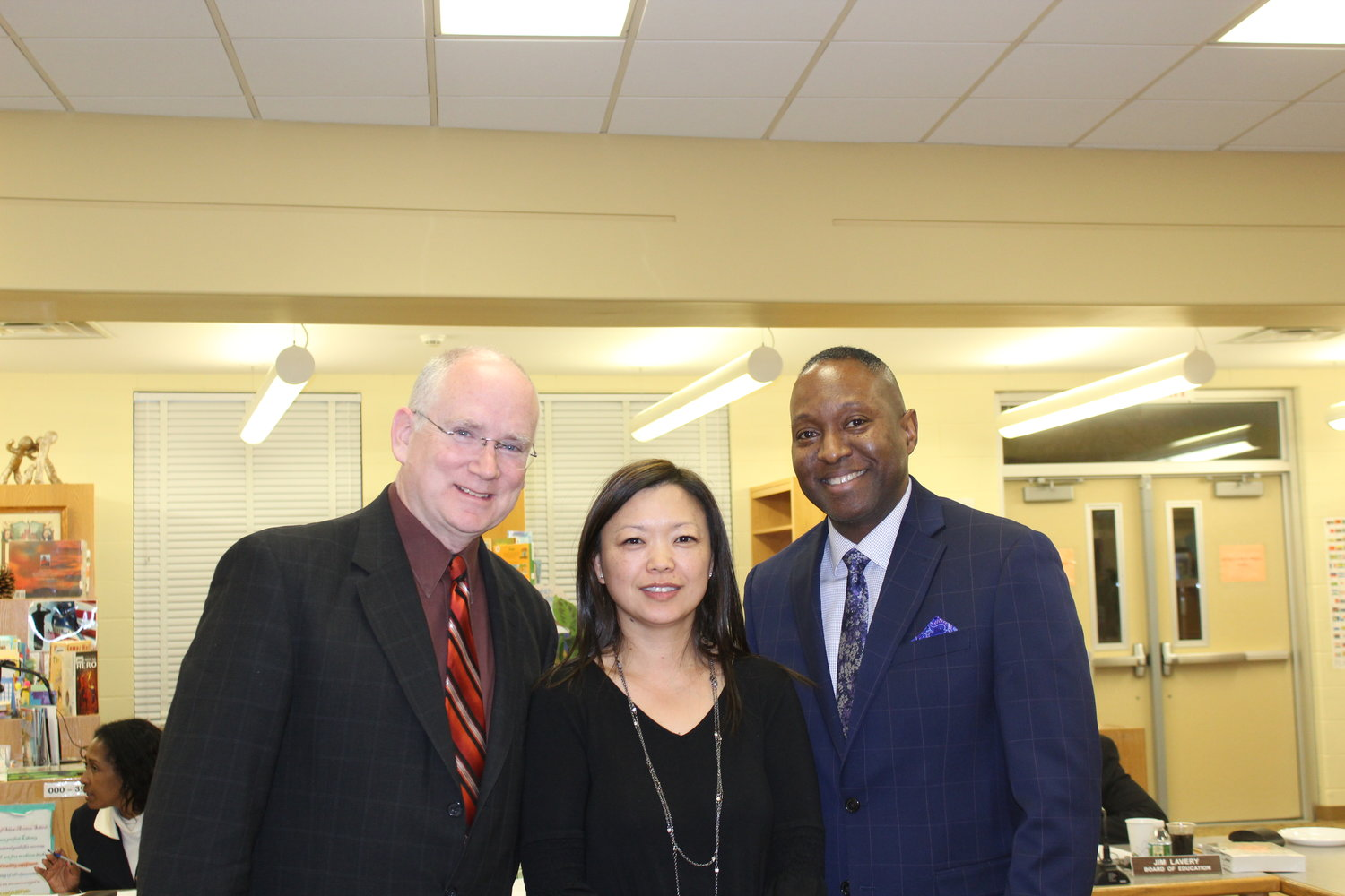 Clear Stream Avenue Assistant Principal Yannie Chon, center, and Principal John Singleton, right, were honored for receiving the Lowe's Toolbox for Education grant. They are with Board President Kenneth Cummings.