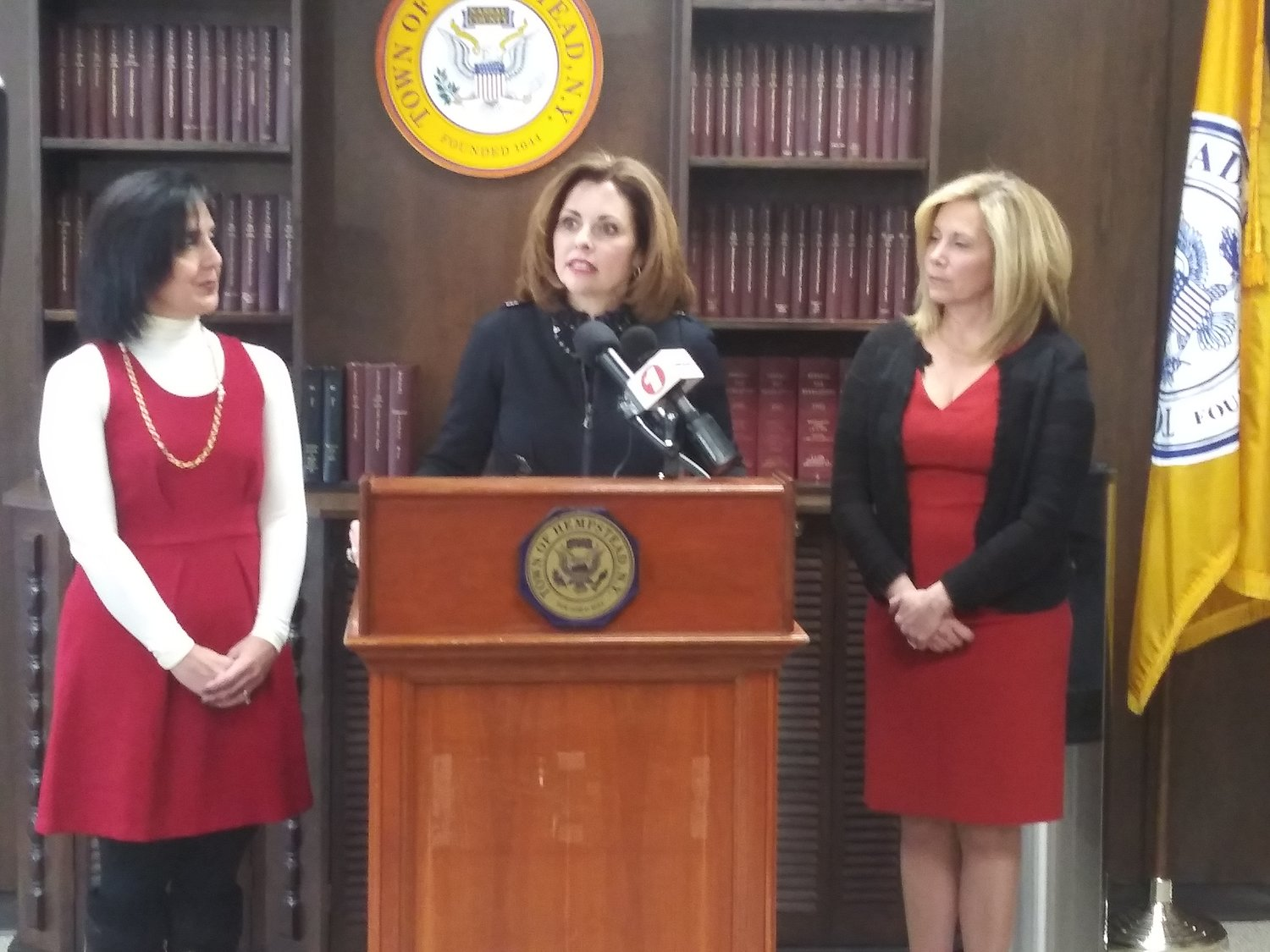 Town of Hempstead Councilwoman Erin King Sweeney, at lectern, joined Town Supervisor Laura Gillen, right, and Town Clerk Sylvia Cabana to announce a pair of bills to address the sale and use of marijuana in the town.