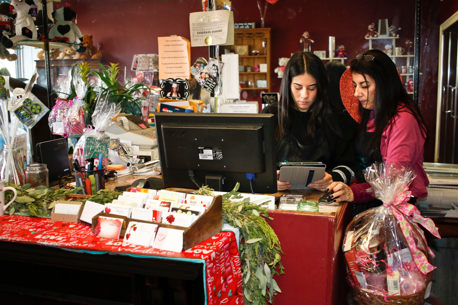Victoria Capabli and her mother Lisa Elfante checking digital orders. They encouraged customers to visit their website at centralflorist.com to make their purchases.