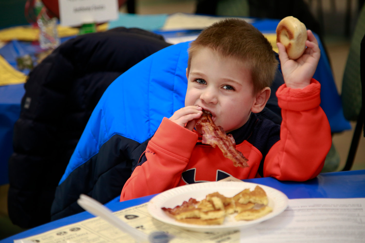 Oceanside Kiwanis hosted its annual Super Bowl Sunday pancake breakfast in the St. Anthony's Church cafeteria. Sean Horbach, 4, was a very hungry attendee.