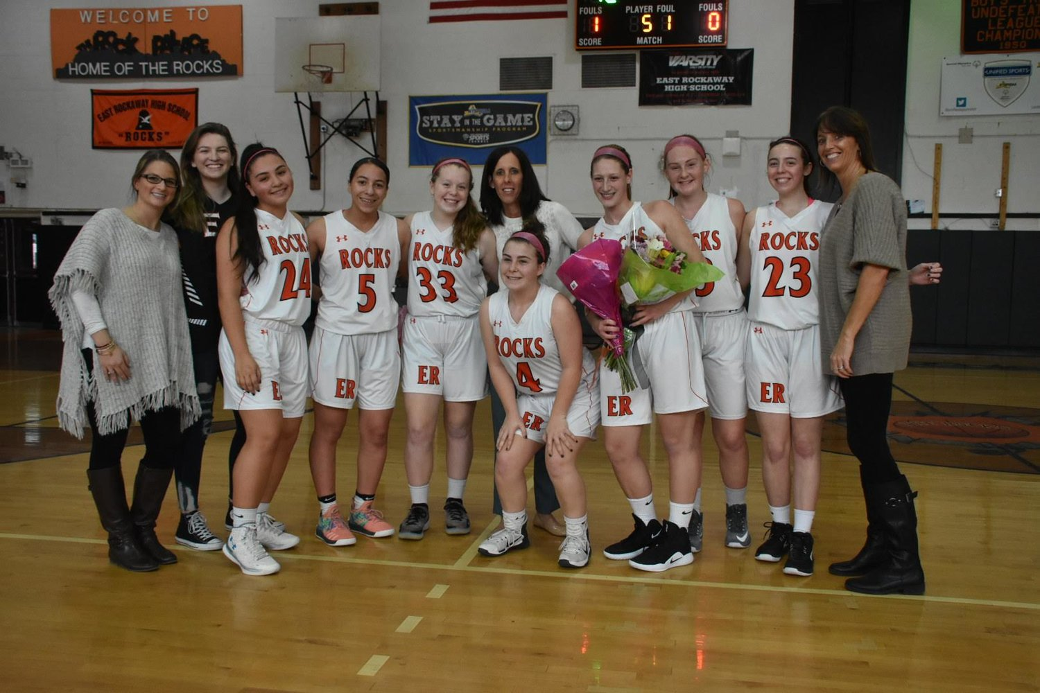 DeGiulio is known as a leader on the team and was surrounded by her teammates after notching the milestone.