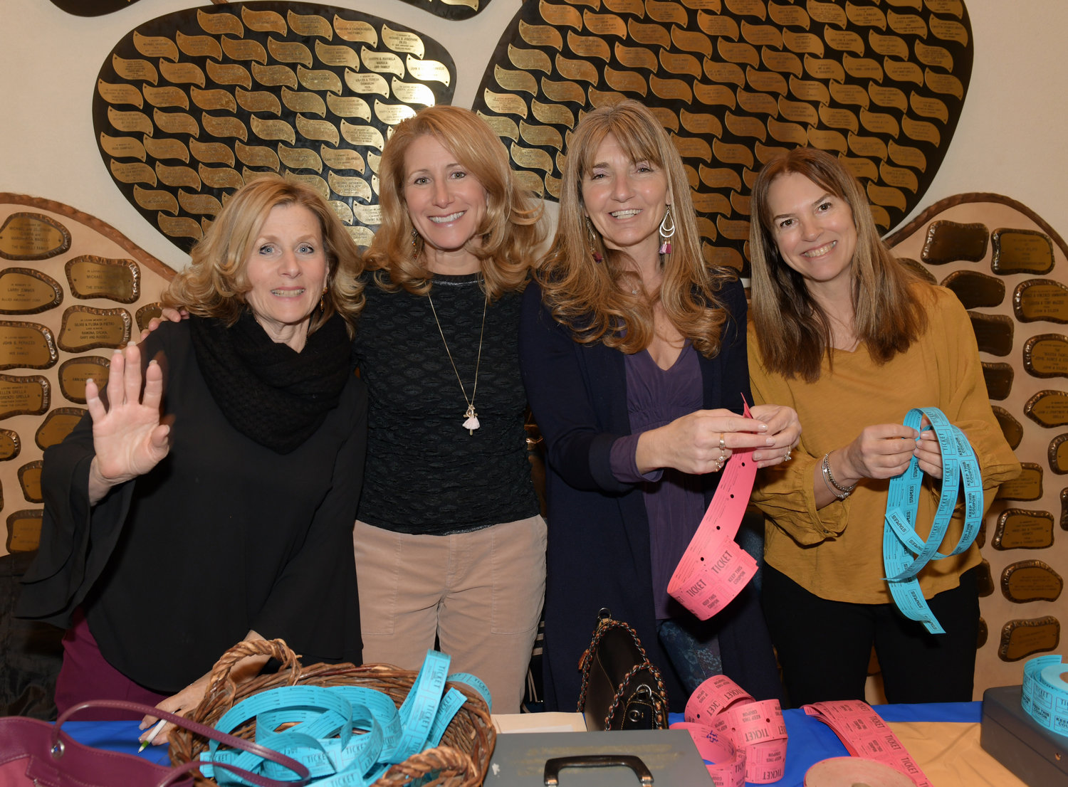 Volunteers selling raffle tickets included, from left, Pamela Panzenbeck, Coleen Spinello, Lisa Travetello and Diane Bruschini.
