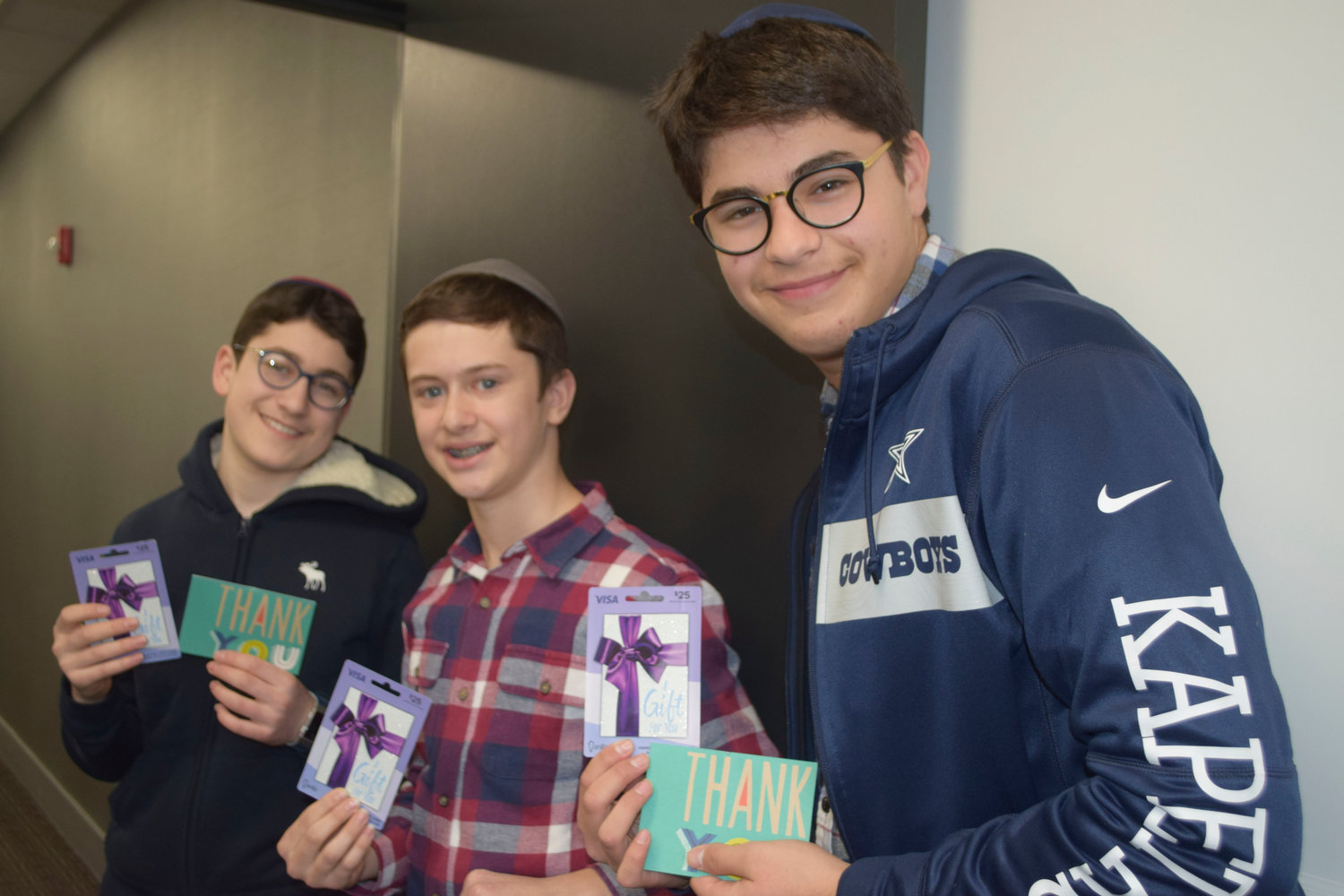 Five Towns residents, Chaim Hecht, left, Shmuel Jacobs and Zaki Kapetas were rewarded for their great deed with $25 Visa cards from Signature Bank.