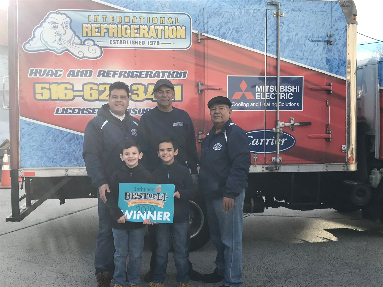 Steve Rios, top left, Rafael Rivera and Julio Rios of Rio International Refrigeration were awarded Long Island's best refrigeration company on their 40th anniversary. Someday Steve's sons, Alex, bottom left, and Damian may be running the company.