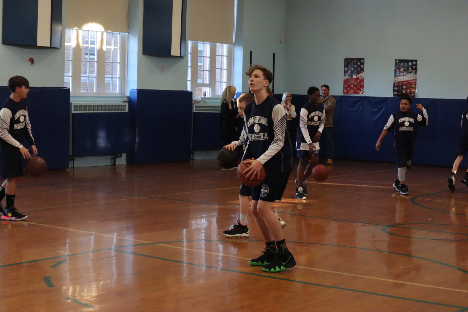 Anthony Follett practiced free throws and drills with the St. Elizabeth Ann Seton team on Monday. A newcomer to the team this season, he blended with the team well, Coach Glenn O'Kane said.