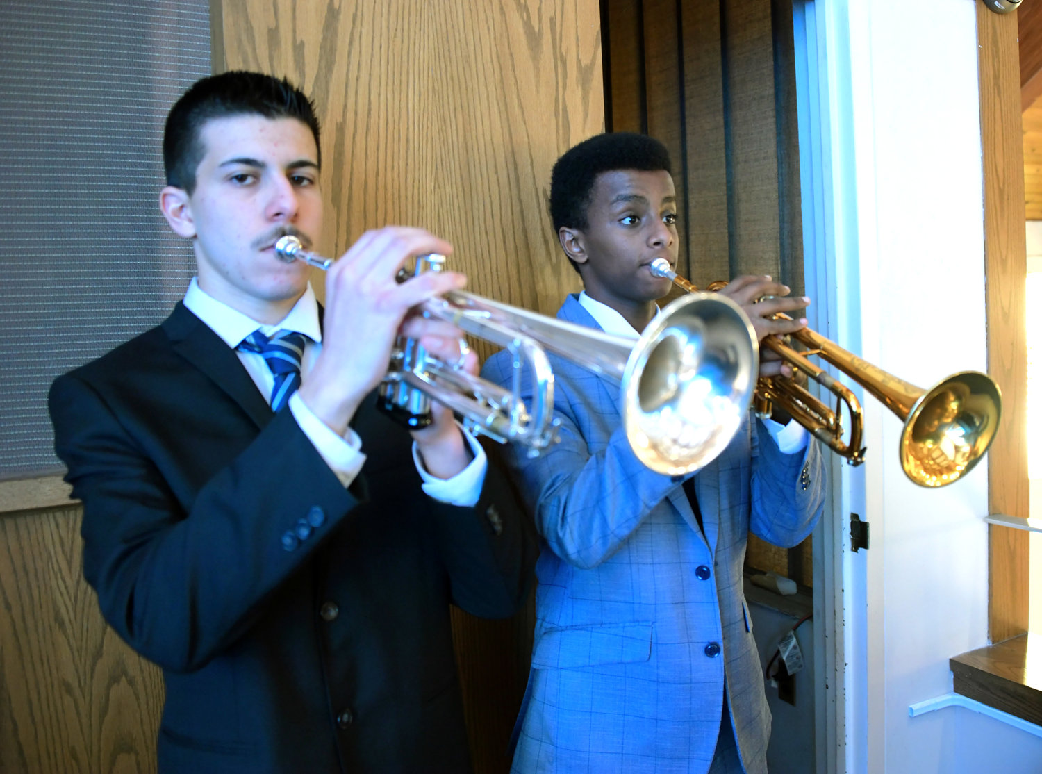 Peter Bennet and Josiah Ashalew played taps during the Four Chaplains ceremony.