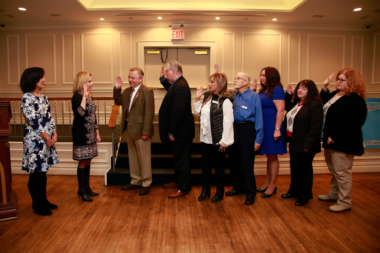 Town Supervisor Laura Gillen, second from left, with Town Clerk Sylvia Cabana, far left, swore in the new and returning Franklin Square Chamber of Commerce officers for 2019.