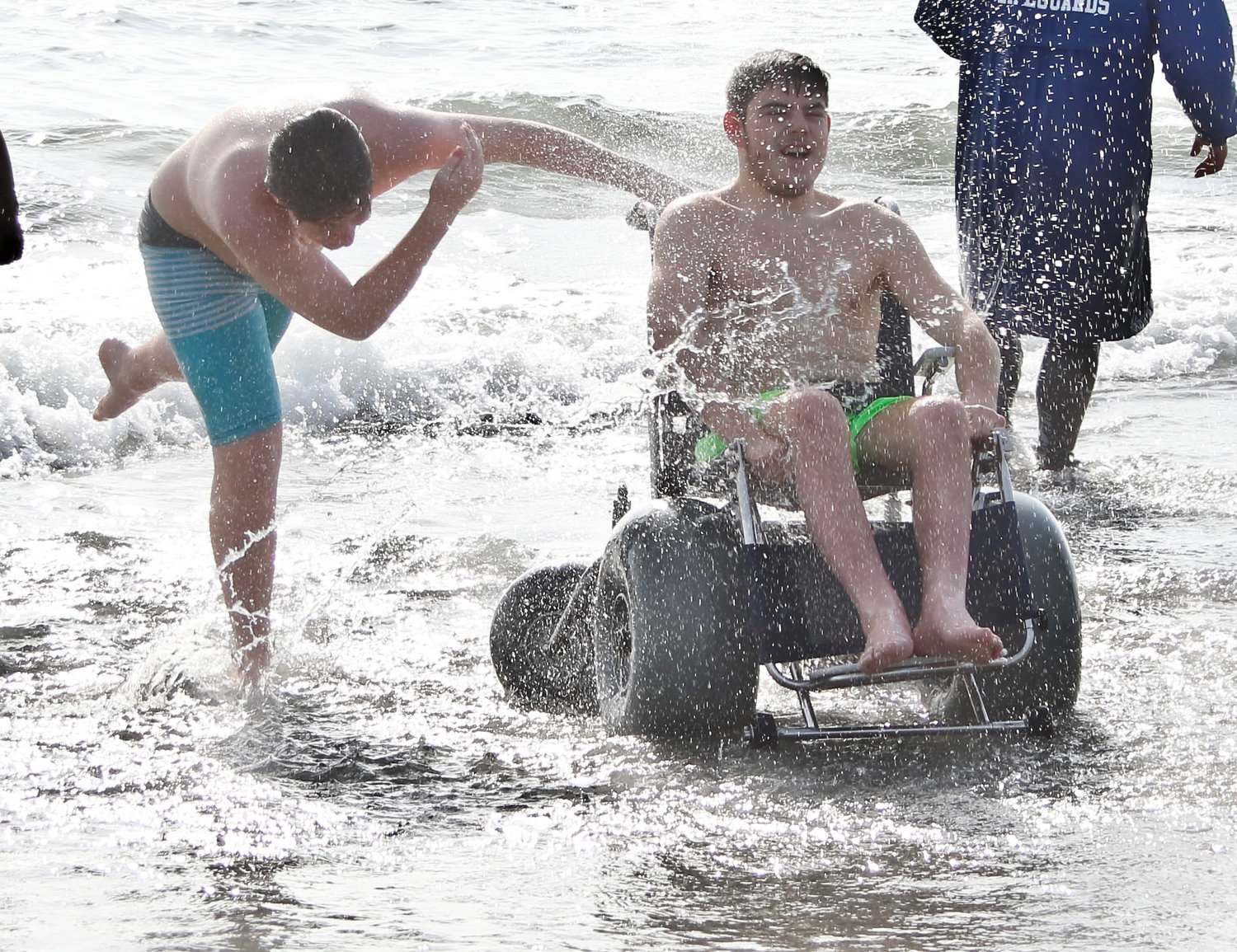 Long Beach resident Robert Browne was splashed by his brother Michael after taking a dip.