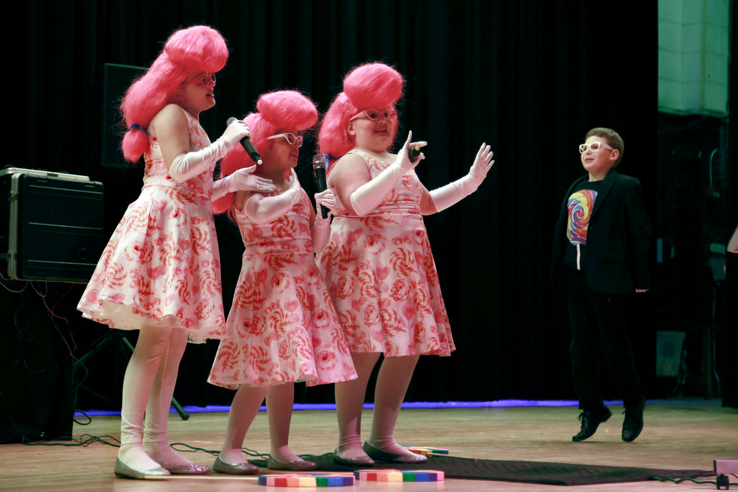 Fourth-graders Haley Katz, far left, Erin Fishman, Hannah Guarineri and Ian Fishman performed the song 'Lollipop' at the LES talent show.