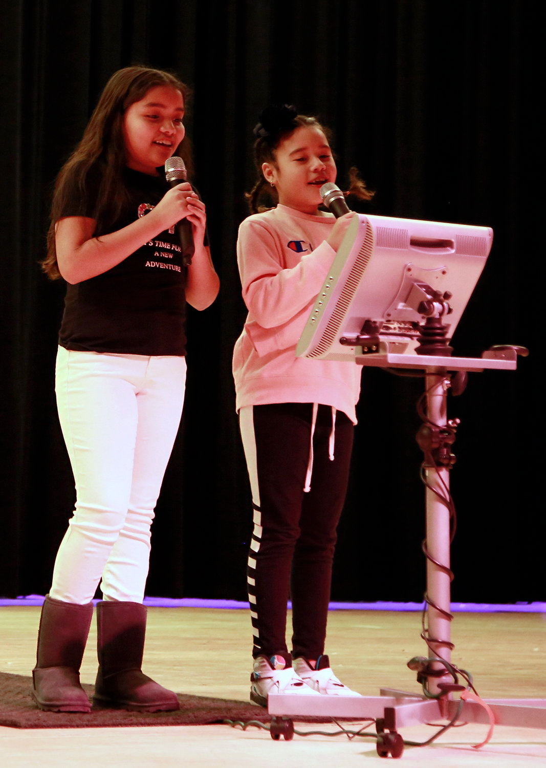 Fifth-grader Angie Navidad, left, and fourth-grader Melanie Vasquez sang 'Young Blood,' at the talent show.
