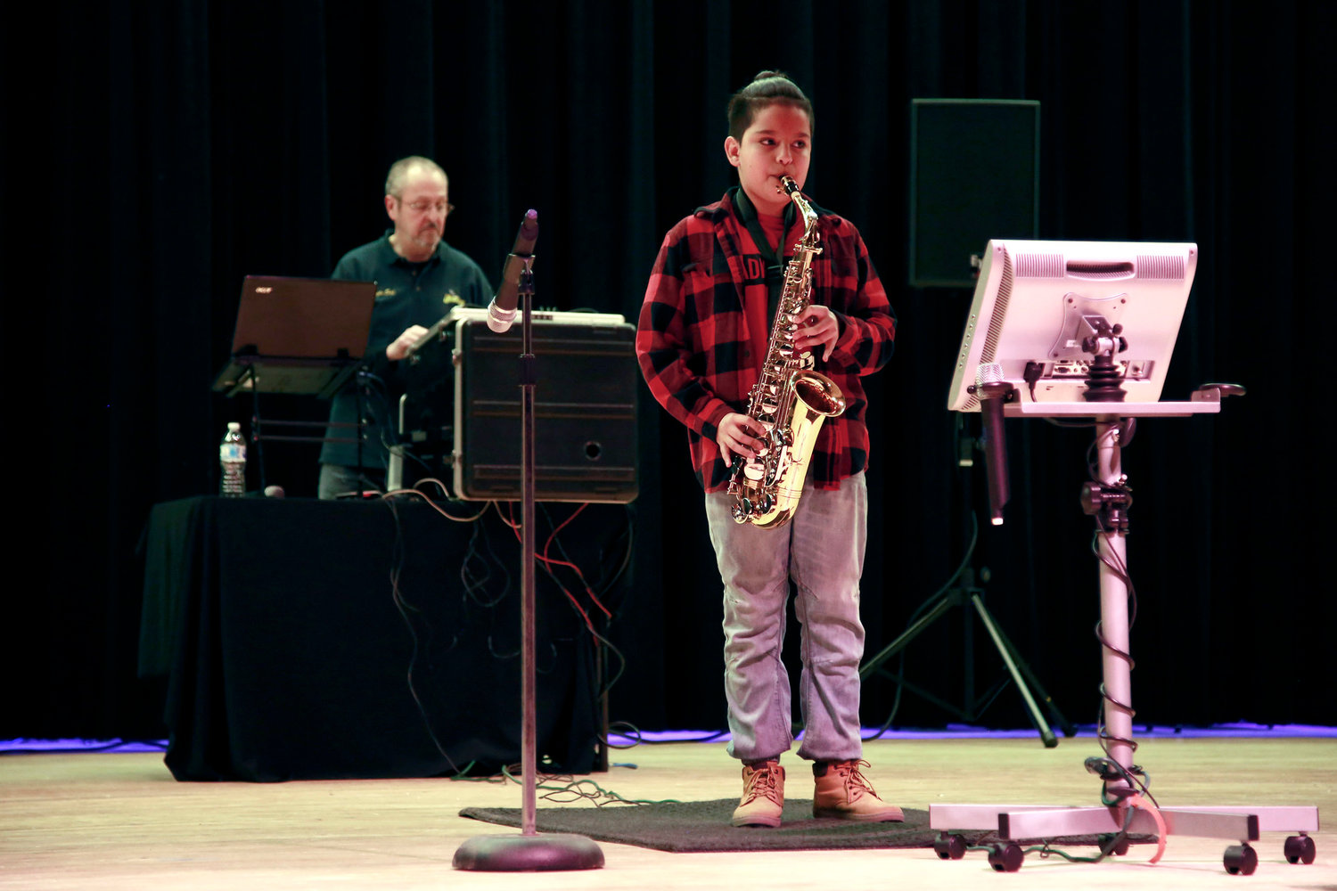 Mailo Rozas Catalan, a fifth-grader, performed a medley of songs on the saxophone.