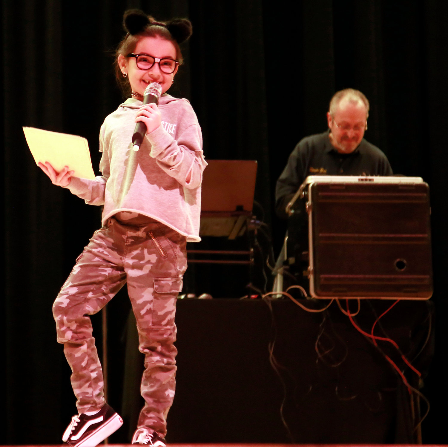 Third-grader Emily Ciaccio entertained the audience with her jokes.