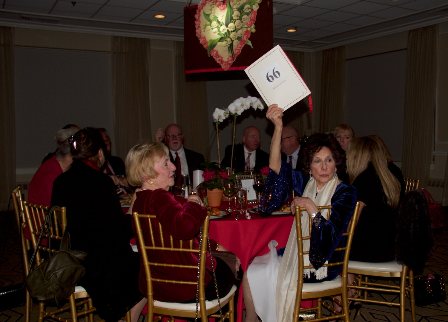 Guests placed bids during the auction portion of the benefit.