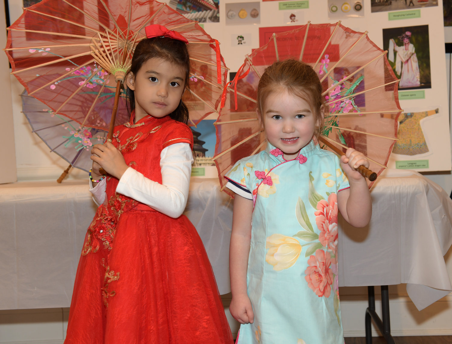 Leah Dimarzo, left, with Joanna Chitty brought out their finest Chinese dresses and parasols for the party.
