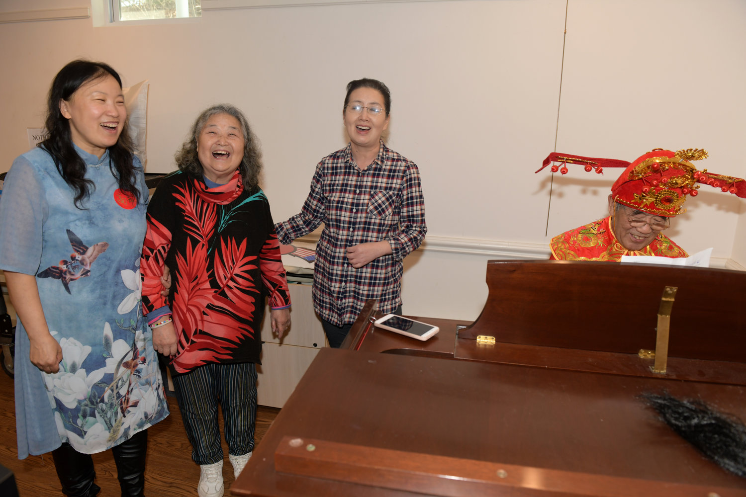 The celebration would not have been complete without the singing of traditional Chinese songs, which were provided by Yun Dimarzo, left, Yun Ping Wang and Wendy Hau who were accompanied by Chang Ming Gao.