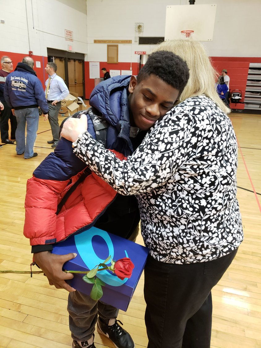 Eighth-grader Martese Davenport showed Patricia Lesser his appreciation for her gift.